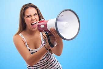 Angry woman screaming through a megaphone