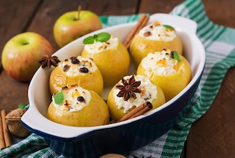 Appetizing baked apples with cottage cheese and raisins