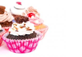 Appetizing chocolate cupcakes with cream