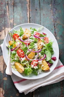 Appetizing salad with cooked potatoes