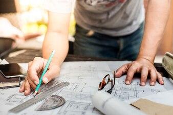 Architect mesuring on plans
