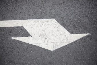 Arrow sign on road surface