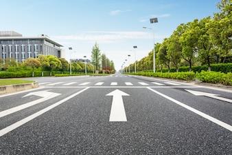 Arrows directions on asphalt
