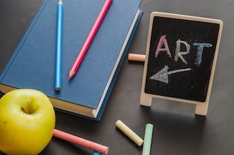 Art book on blackboard