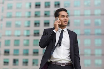 Asian Business Man Talking on Phone Outside