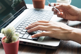 Asian woman hands using laptop and credit card, Online shopping, Business concept