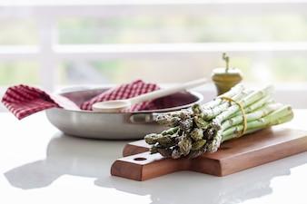 Asparagus on a wooden board near a cloth
