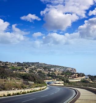 Asphalt road through  cliffs