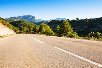 Asphalt road through mountains