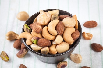 Assorted mixed nuts in bowl on the table