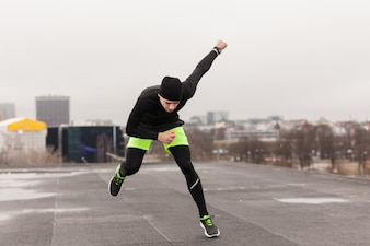 Athlete doing exercises on rooftop