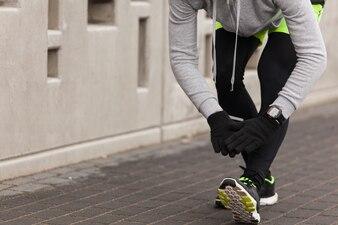 Athlete tying shoes