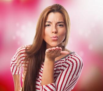 Attractive female sending an air kiss