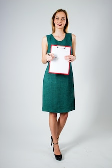 Attractive modern young Business woman with clipboard.