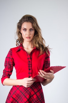 Attractive modern young Business woman with clipboard