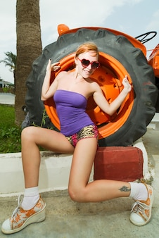 Attractive red girl with tactor wheel