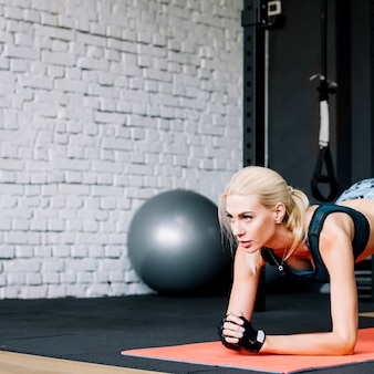 Attractive woman doing plank exercise