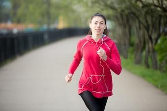 Attractive woman enjoying jogging outdoors
