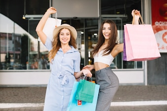 Attractive women demonstrating paper bags