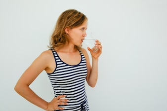Attractive Young Woman Drinking Water From Glass
