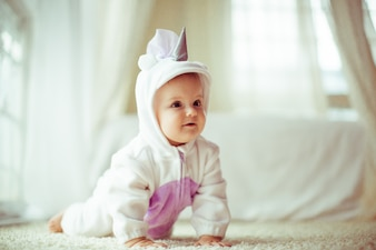 Baby crawling in full body pajamas