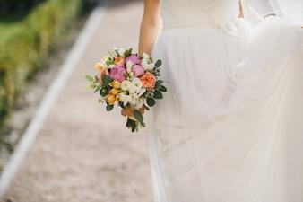 Back bride with a bouquet