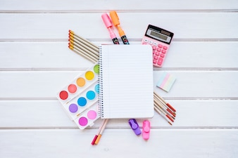 Back to school composition with notepad on wooden surface