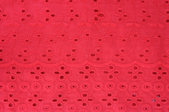 Background from red lace with pattern from flower