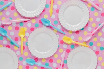 Background of white plates and spoons