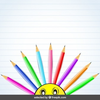 Background with colorful pencils and emoticon
