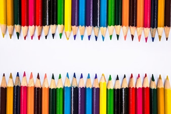 Background with multi-colored pencils in a row