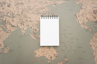 Background with vintage world map and blank notebook