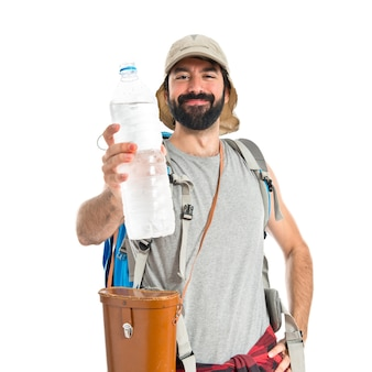 Backpacker drinking water over white background