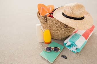 Bag with beach accessories on sand