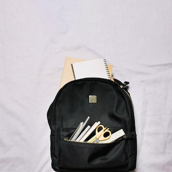 Bag with sketchbooks and office supplies