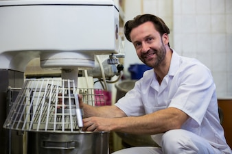 Baker adjusting dough machine