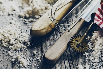 Baking concept kitchen cooking cutlery accessories for baking on wooden background with flour. Closeup. Cooking Process.
