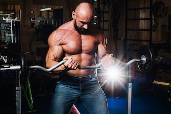 Bald man lifting barbell