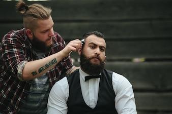 Barber using a razor