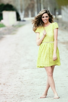 Barefoot teen with yellow dress