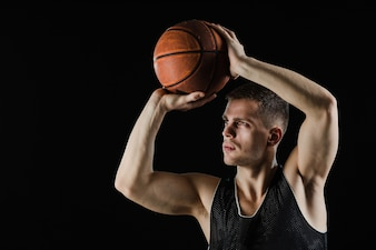 Basketball player ready to throw the ball
