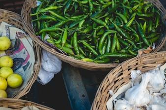 Baskets full of peppers, garlic, and lemons