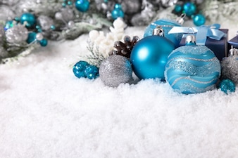 Baubles and decoration on the snow