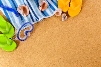 Beach background with scuba mask and flip flops