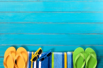 Beach border scene with sunglasses and flip flops