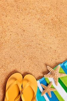 Beach with yellow flip-flops