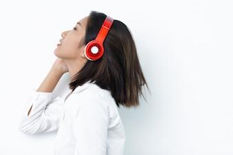 Beautiful Asian Woman Enjoying Listening to Music