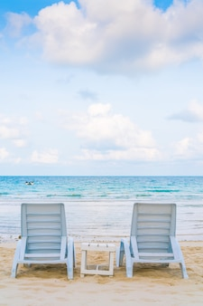 Beautiful beach chairs on tropical white sand beach
