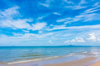 Beautiful beach with sea and ocean on blue sky
