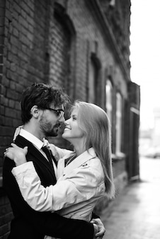 Beautiful couple hugging in black and white